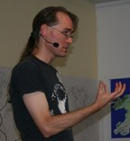 ChrisSeemanSpeaking SideView Handraised Cropped
