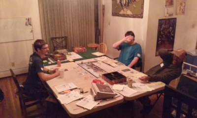 2014 Tolkien Moot X day 2 after hours gaming, camera shy gamers playing The Hobbit board game by Fantasy Flight Games